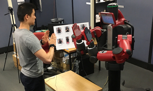 Teaching a Robot Bimanual Hand-Clapping Games via Wrist-Worn {IMU}s