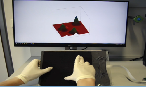 A Large-Scale Fabric-Based Tactile Sensor Using Electrical Resistance Tomography